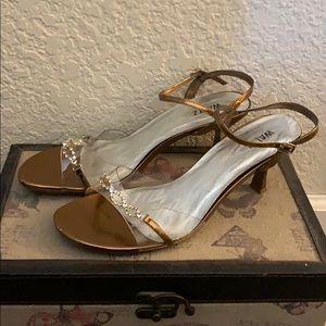 1 pair of heels, 1 pair or dressy sandals included